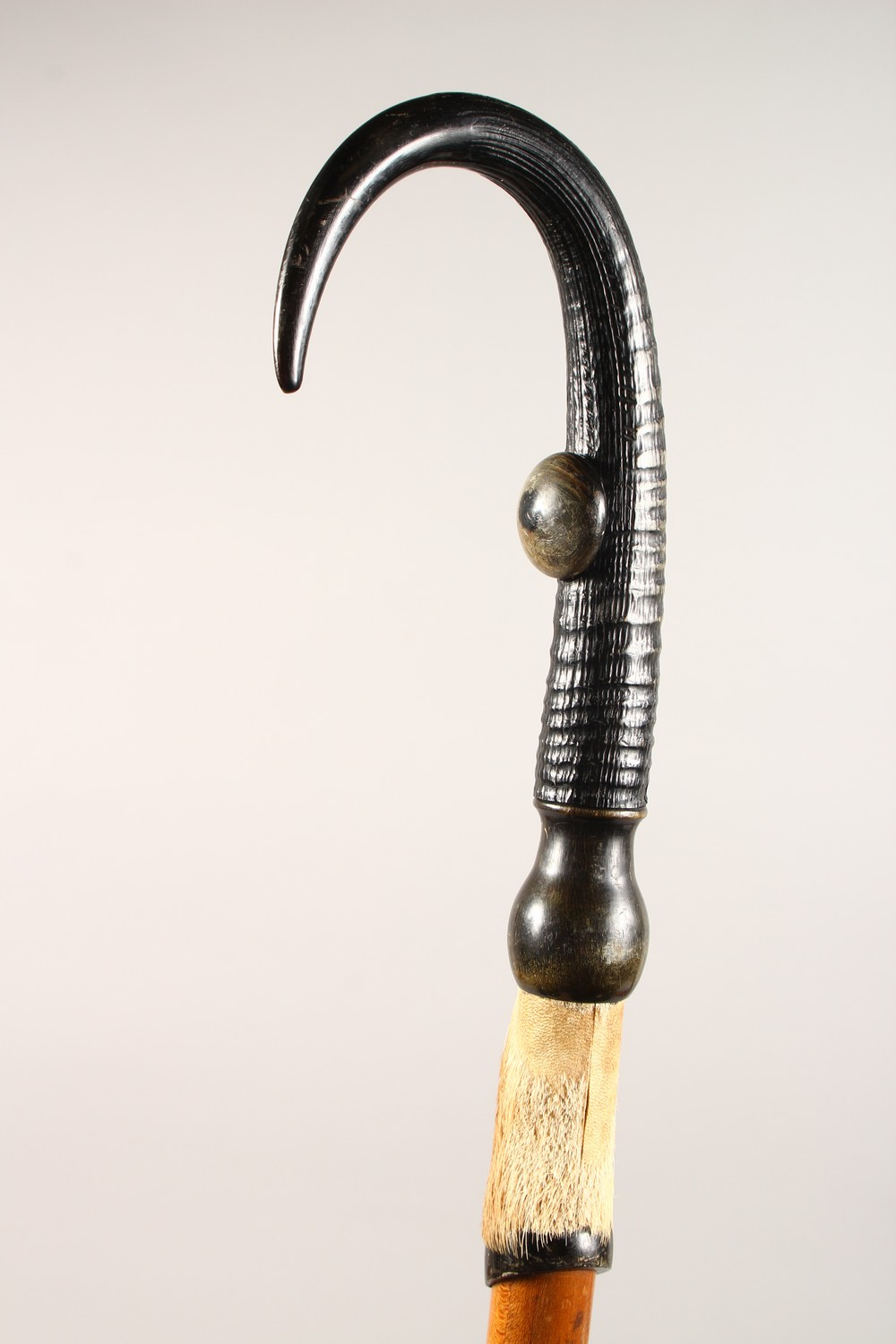 Lot 1515 - AN ALPINE WALKING STICK, with hoof handle. 39ins long.