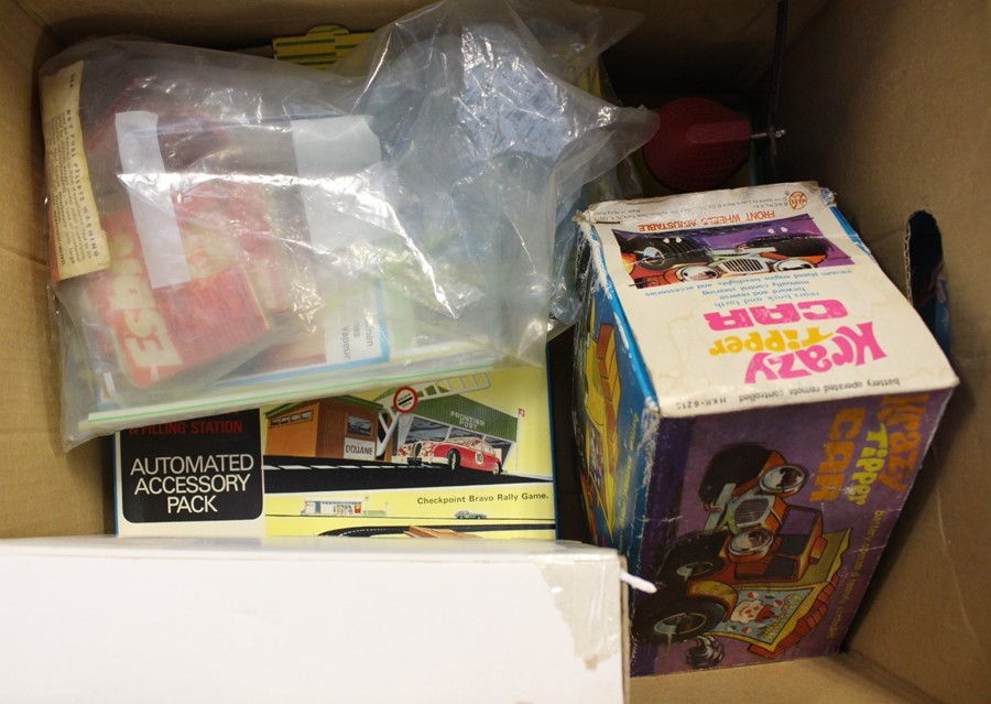Lot 3153 - A collection of assorted toys to include: Marx Krazy Tipper Car; Minic Automated Accessory Pack