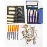 A collection of flat wares with cased butter knives with silver handles and silver christening