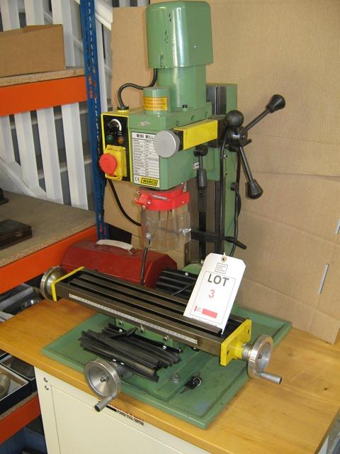 """Lot 3 - Warco mini Milling machine 18"""" x 4"""" table, 3 Morse taper spindle 240v mounted on Cabinet"""