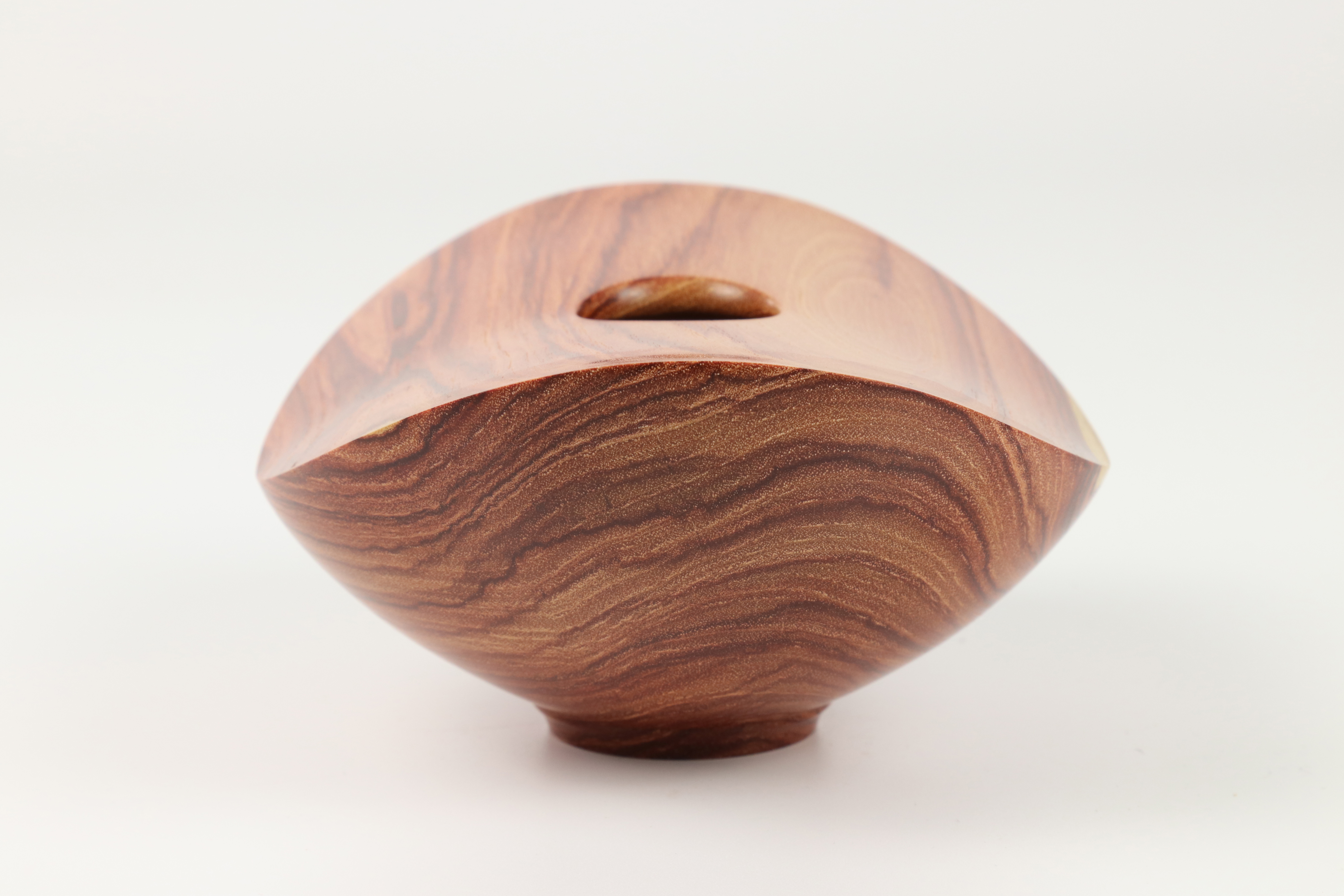 Lot 91 - Paul Hannaby (UK) brazillian tulipwood multi axis hollow form 7x14cm. Signed