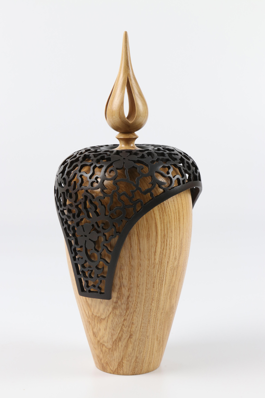 Lot 64 - Margaret Garrard (UK) ash lidded form with pierced shroud 24x10cm. Signed