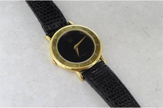 eb9d4360d Ladies' Gucci watch, black dial with gilt hands, gold plated case ...