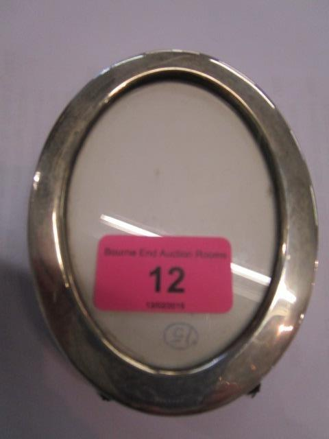 Lot 12 - An oval silver photo frame