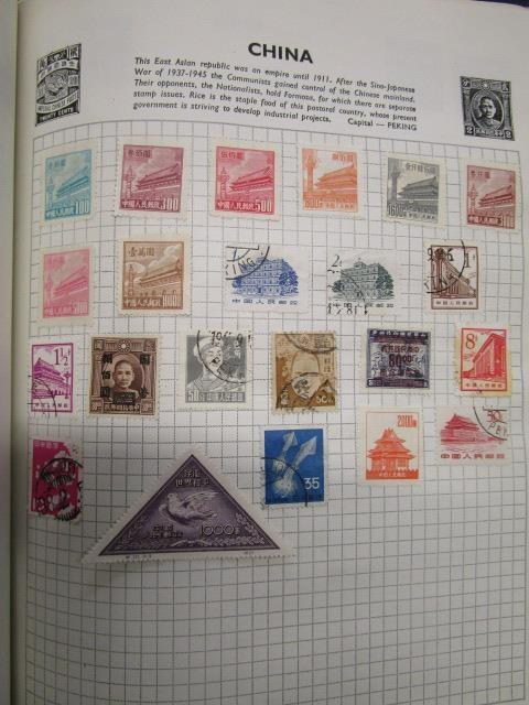 Lot 21 - A Stanley Gibbons Swiftsure stamp album containing stamps from China, Hong Kong and various other