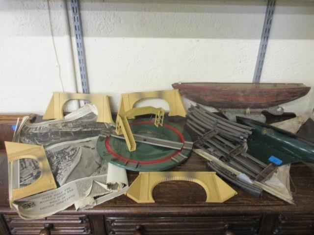 Lot 19 - A Tri-ang tin boat with sail and a wooden boat, together with a Hornby train turntable, mixed