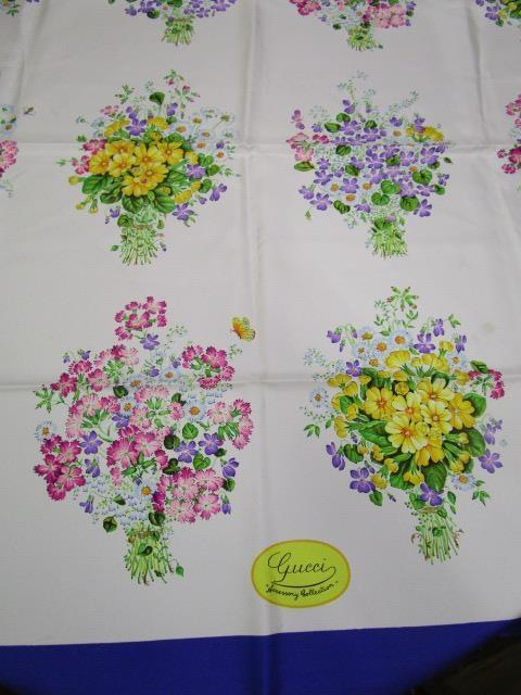 """Lot 4 - A vintage Gucci silk scarf, 35"""" x 34"""" depicting bouquets of wild flowers"""