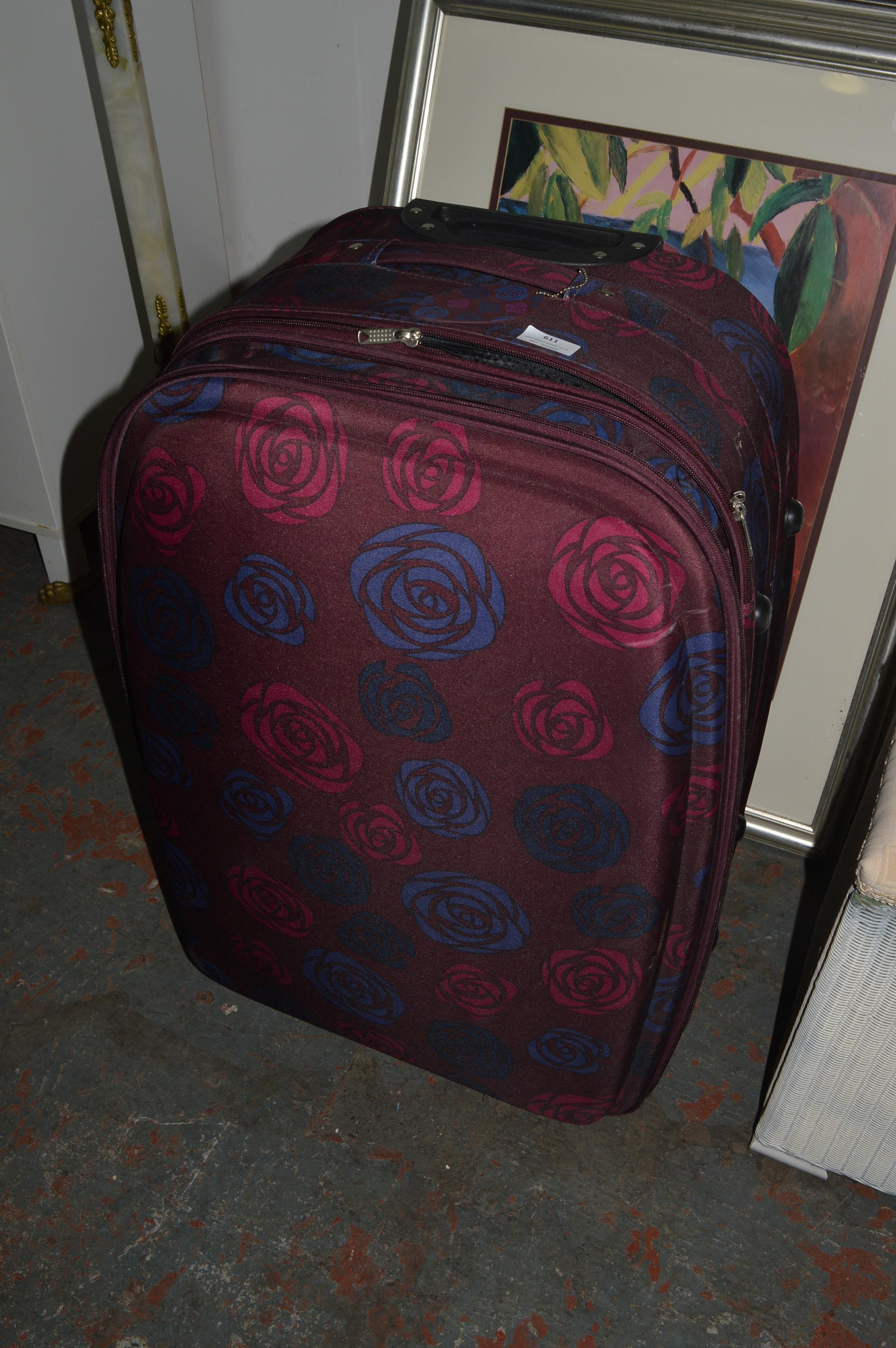 Lot 611 - Large Pull Along Suitcase (Floral Design)