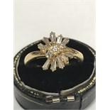 BAGUETTE & ROUND DIAMOND RING MARKED 750 & 18k