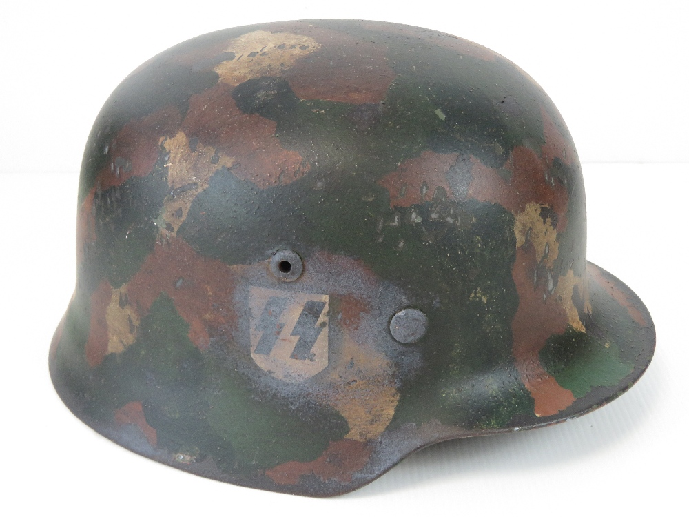 A fine replica WWII German SS Infantry helmet with single decal and 'Splotch' style camouflage