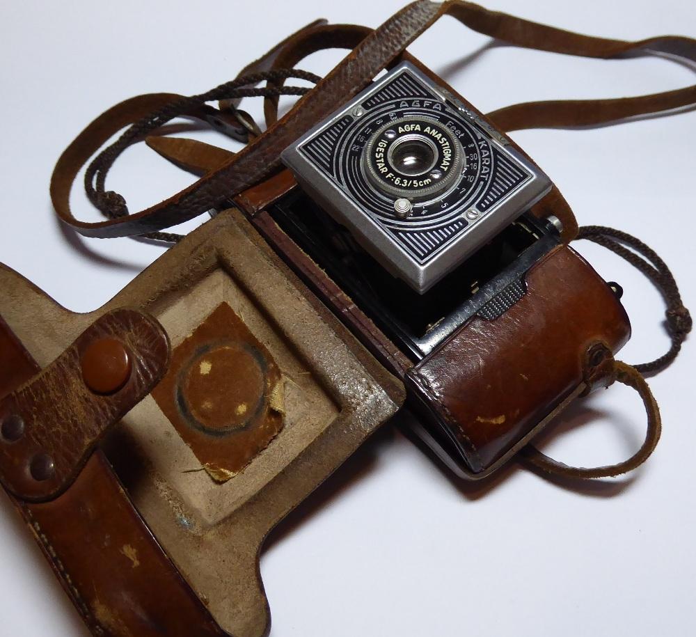"An Agfa Karat camera in original leather case inscribed ""LIEUT H.F. NORTH, R.I.A.S.C, DELHI 1941""."