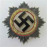 A WWII 'Gold' German Cross badge, pin stamped '20'.