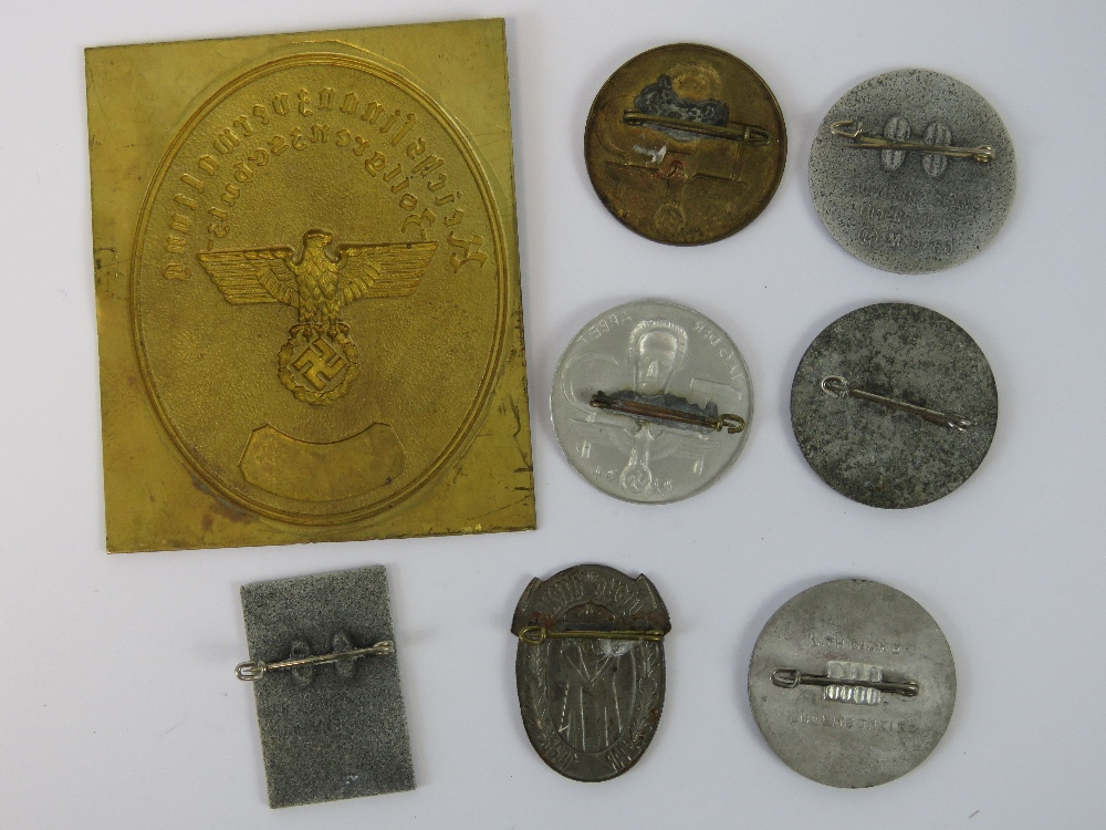 Lot 53 - Seven WWII German Day badges together with an uncut Customs Border Protection shield. Eight items.