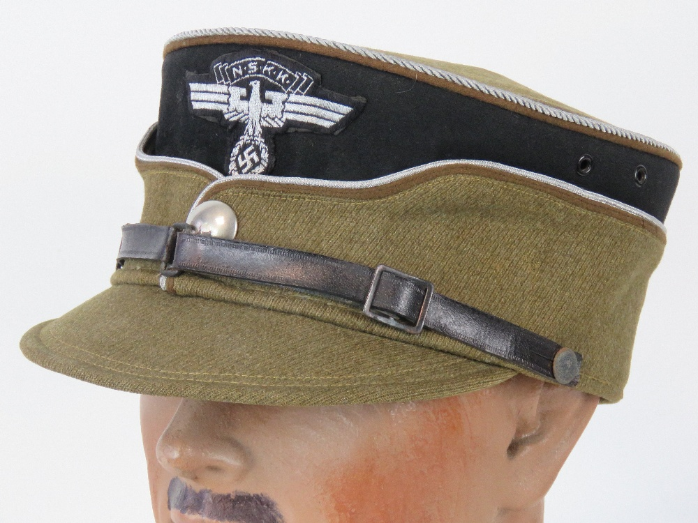 A rare WWII German NSKK Officers kepi, stiffened peak with silver thread piping,