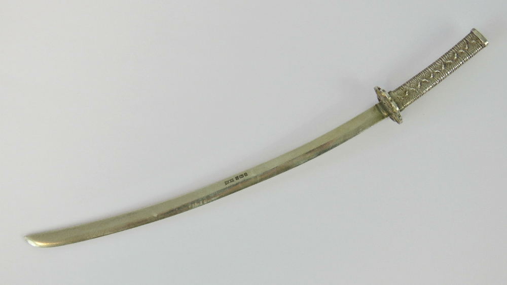 A HM silver miniature Japanese sword (odachi or nodachi) made by Walker & Hall,
