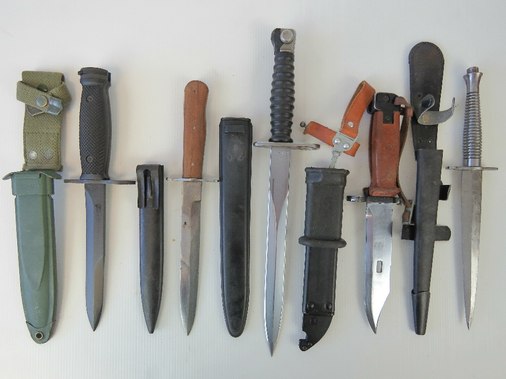 Lot 35 - Five military knives and bayonets including; U.S. M16, Soviet AKM and WWII German boot knife.