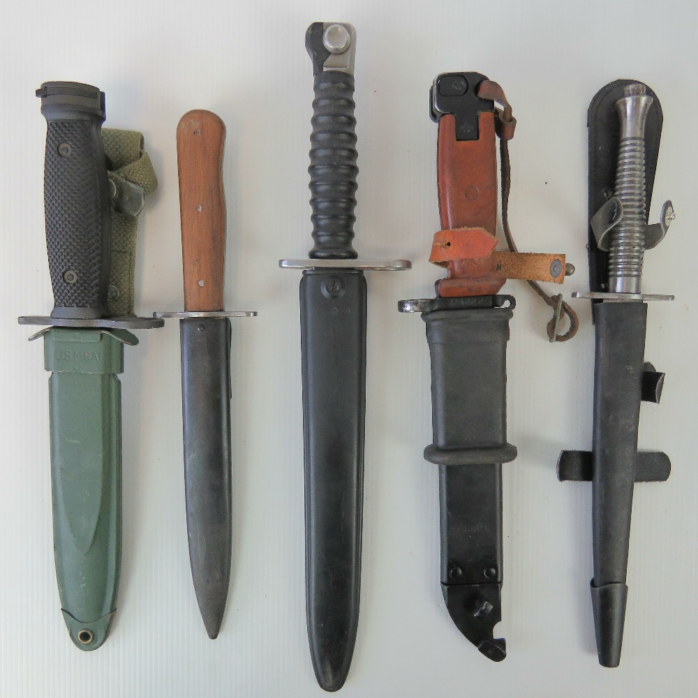 Five military knives and bayonets including; U.S. M16, Soviet AKM and WWII German boot knife.