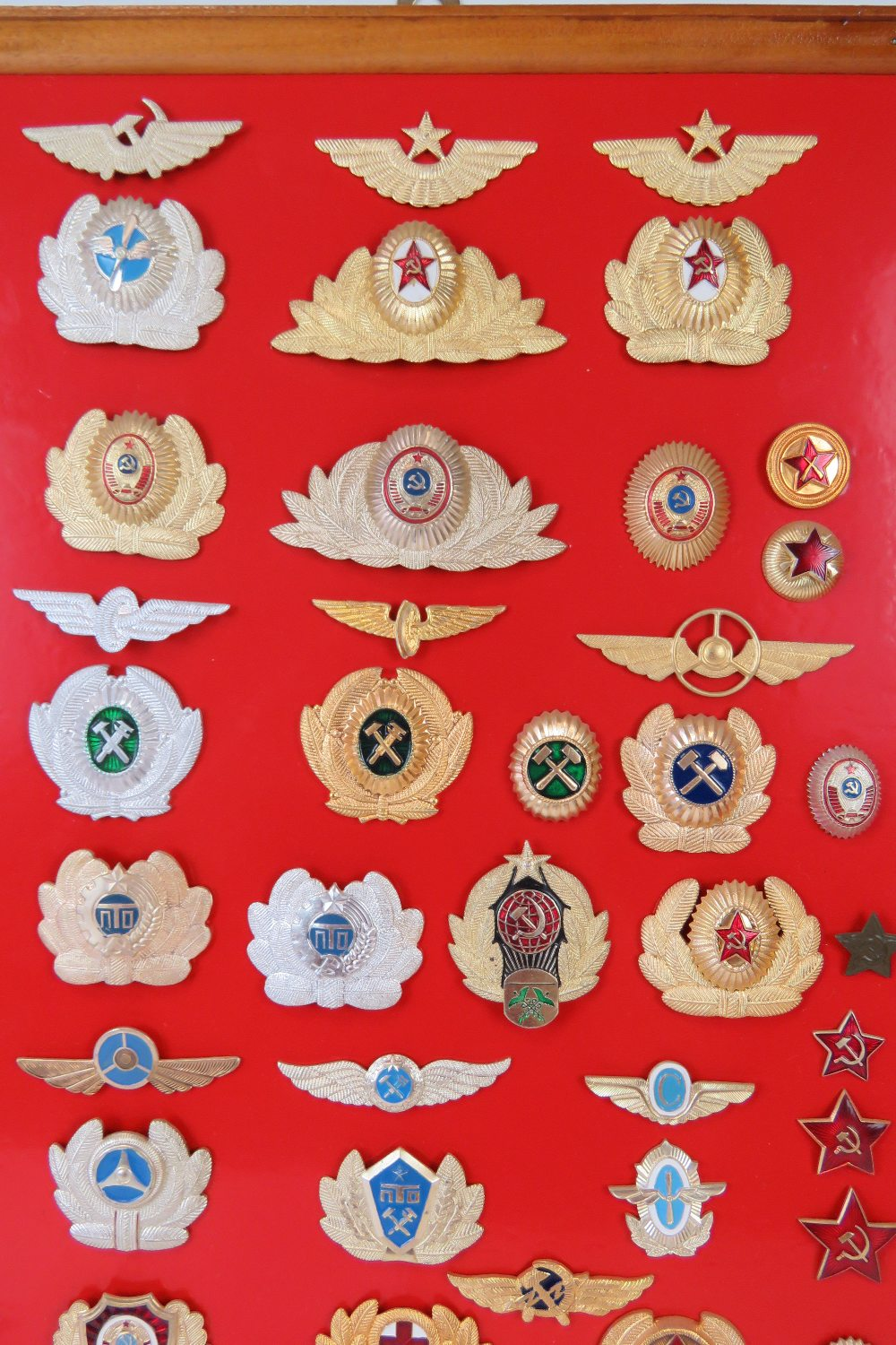 A collection of Russian USSR badges mounted on board, fifty-five items. - Image 2 of 3