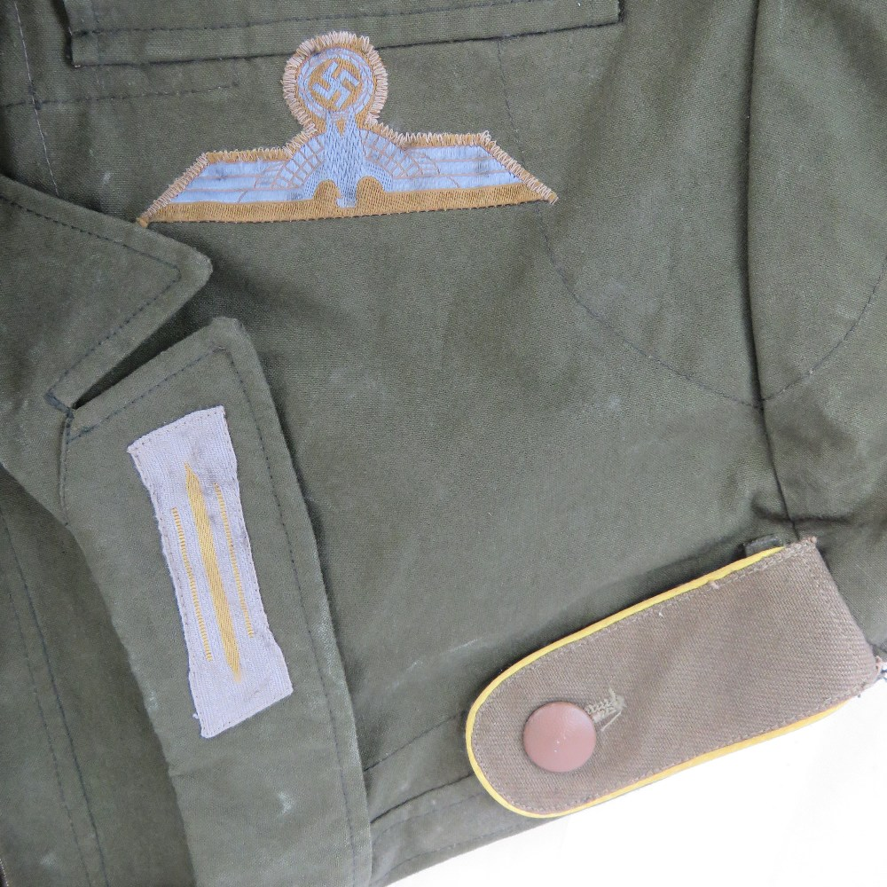 A WWII German Afrika Korps tunic complete with cuff title and cloth badges. - Image 2 of 2
