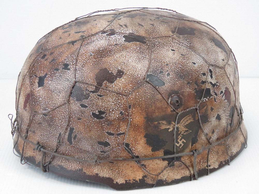 Lot 9 - A fine replica WWII Luftwaffe Paratroopers Fallschirmjäger helmet with two decals,