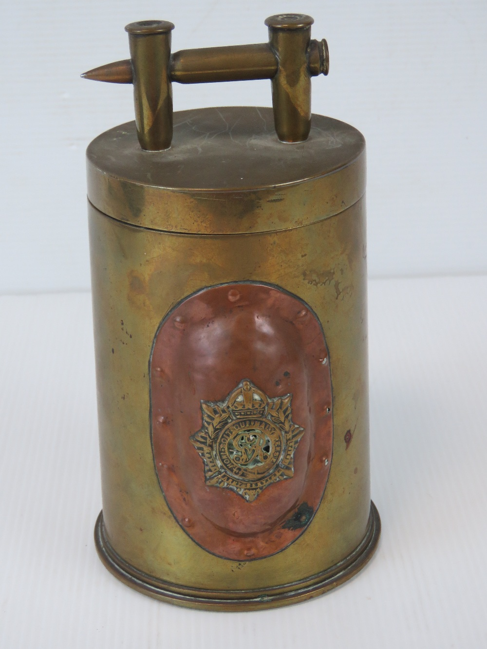 A trench Art shell case lidded pot having Royal Army Services Corps and Canadian Military badges