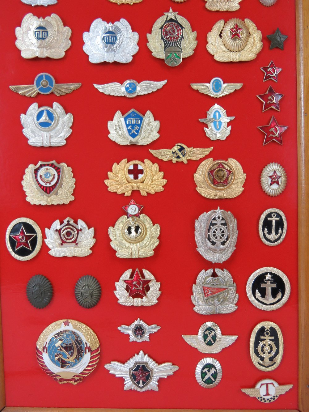 A collection of Russian USSR badges mounted on board, fifty-five items. - Image 3 of 3