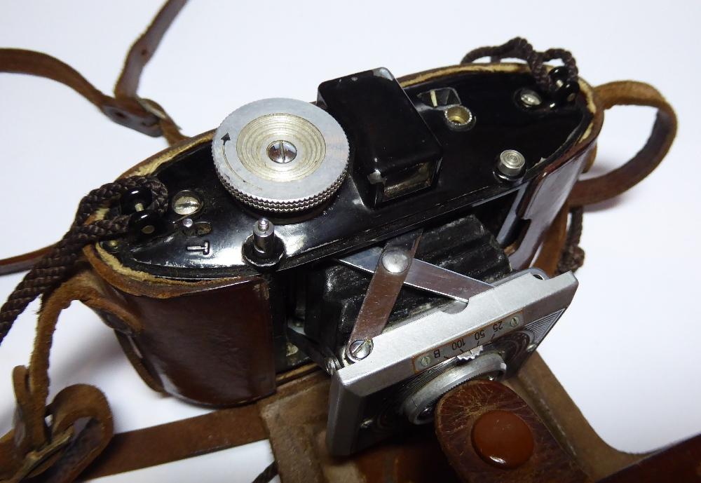 "An Agfa Karat camera in original leather case inscribed ""LIEUT H.F. NORTH, R.I.A.S.C, DELHI 1941"". - Image 4 of 4"