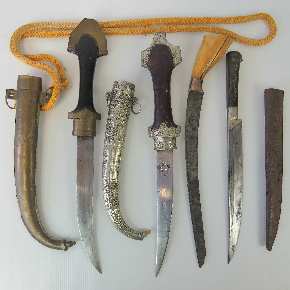Lot 33 - Two Jambiya daggers each having metal covered sheath, together with two hunting knives. Four items.