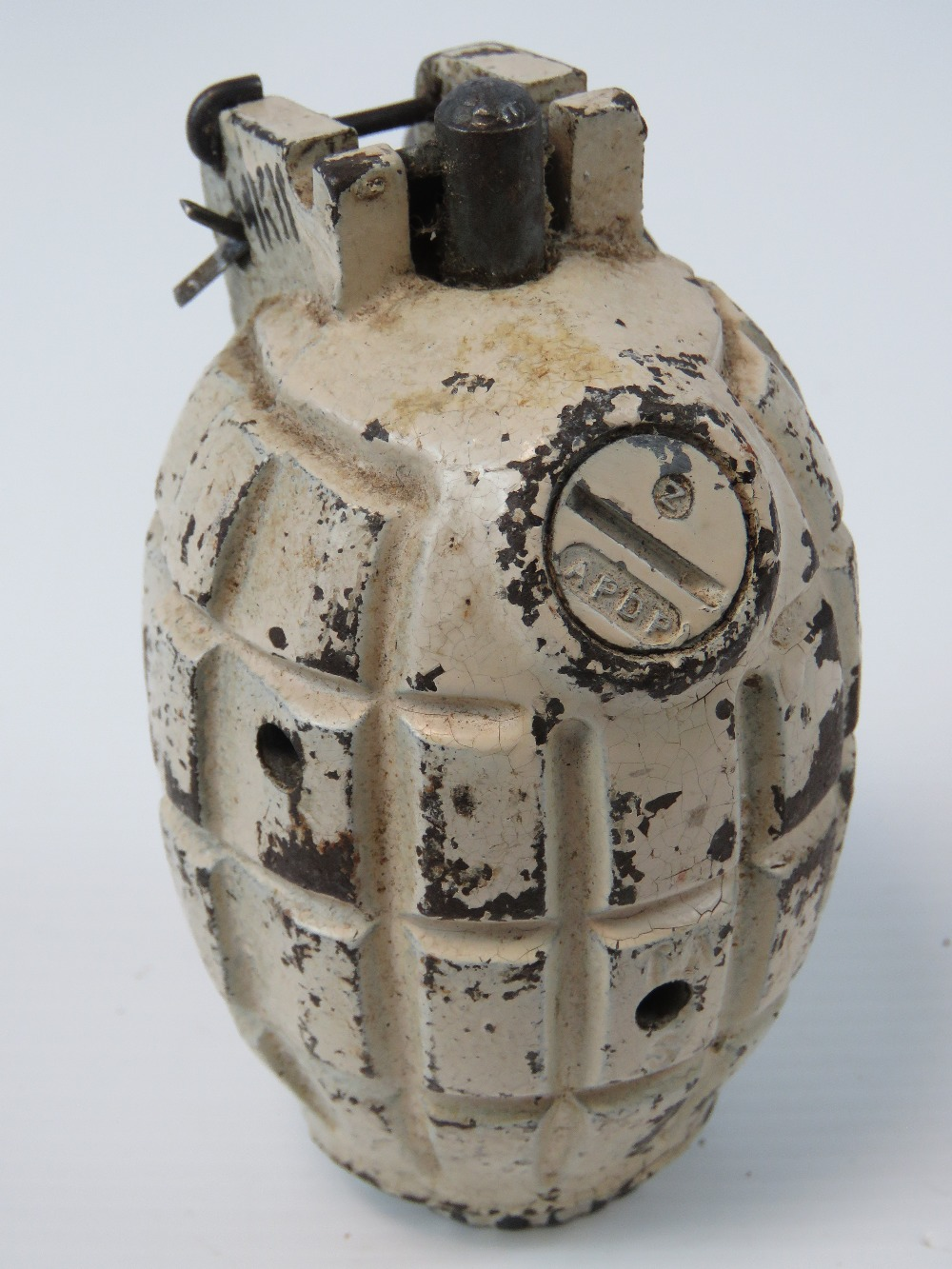 An inert British WWII Mk2 Mills grenade, painted in Artic /Winter camouflage, fuse plug dated 1945. - Image 2 of 3