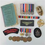 A collective lot of two miniature medal groups, ribbon and cloth badges, coinage, etc.