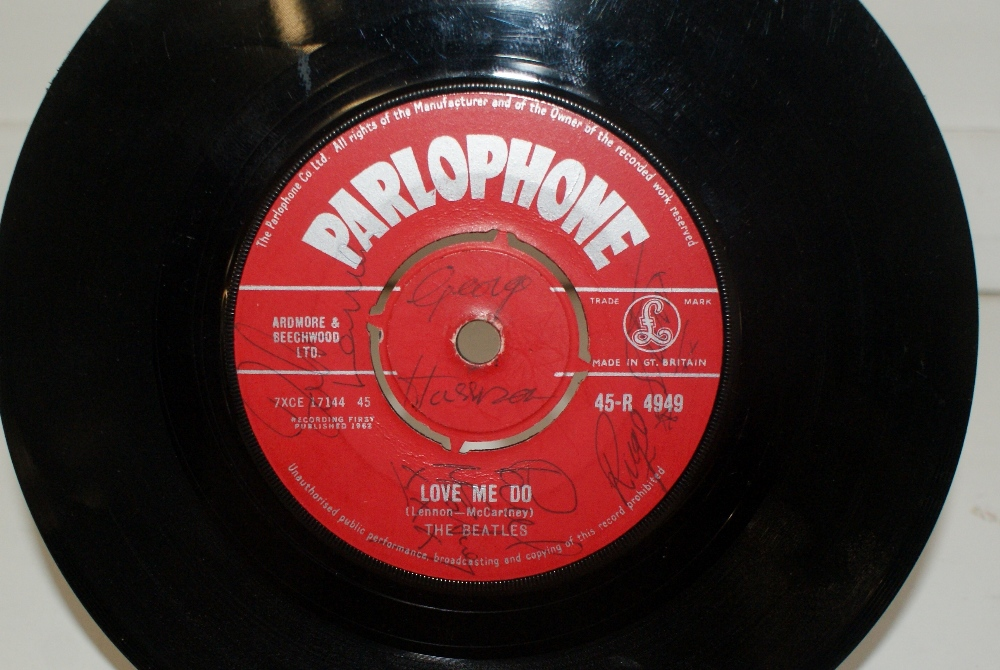 Lot 38 - A Fully signed first pressing of the Beatles debut single 'Love me Do' from Dawson's Music shop