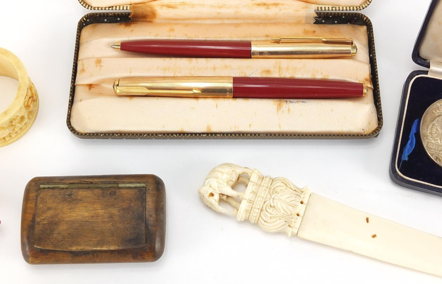 Lot 43 - Antique and later objects including a Parker 61 pen set, Indian carved ivory letter opener, pair