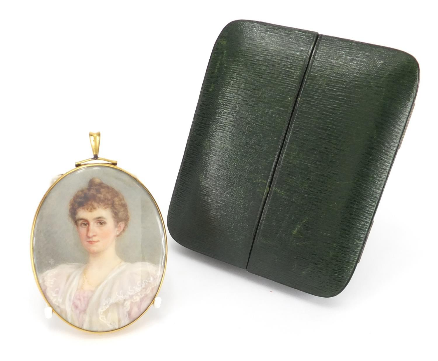 Lot 2 - Oval Georgian hand painted portrait miniature of a female, housed in a gilt metal mouring locket