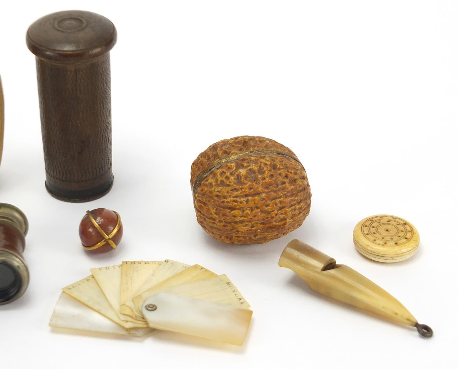 Lot 36 - Antique and later objects including a Mother of pearl and ivory aide memoire, novelty horn hand