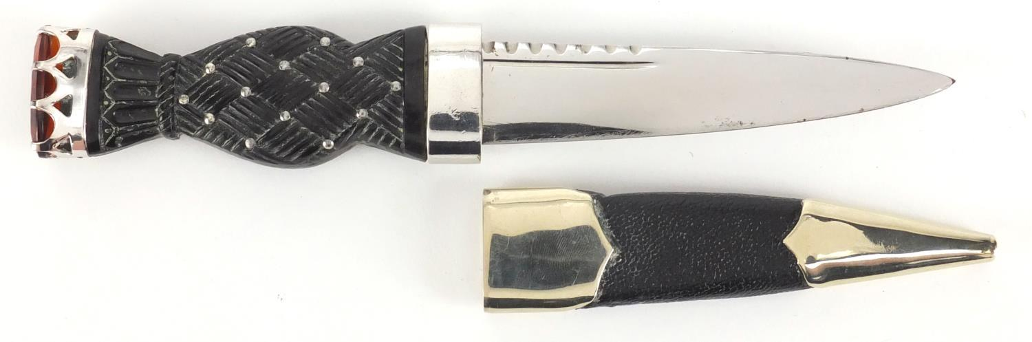 Lot 60 - Scottish Skean Dhu with basket weave design grip and leather sheath, the mounts impressed Ar Durant,