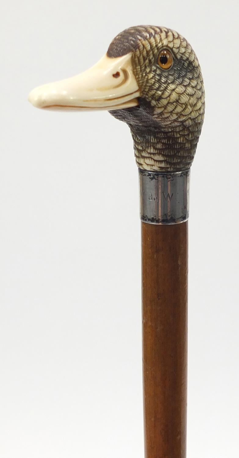 Lot 25 - 19th century parasol with carved ivory ducks head handle by Brigg & Sons, the ducks head having