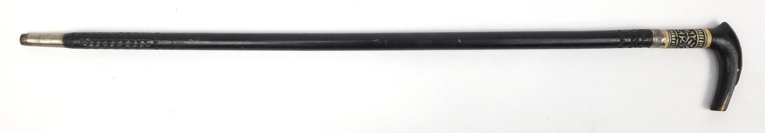 Lot 26 - Indian ebonised and carved bone sword stick with steel blade, 91cm in length :For Further