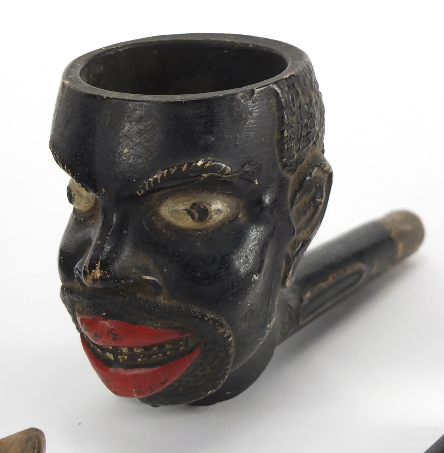 Lot 48 - Five antique and later pipes including including a Blackamoors head and Meerschaum example with