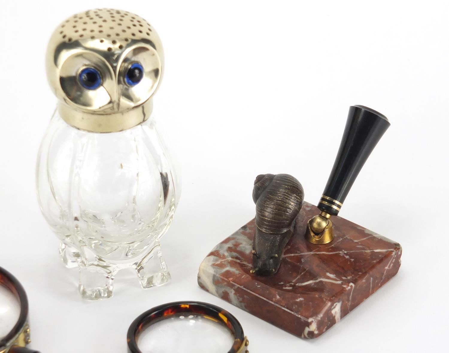 Lot 37 - Antique and later objects comprising a novelty owl design sifter with silver plated lid, marble desk