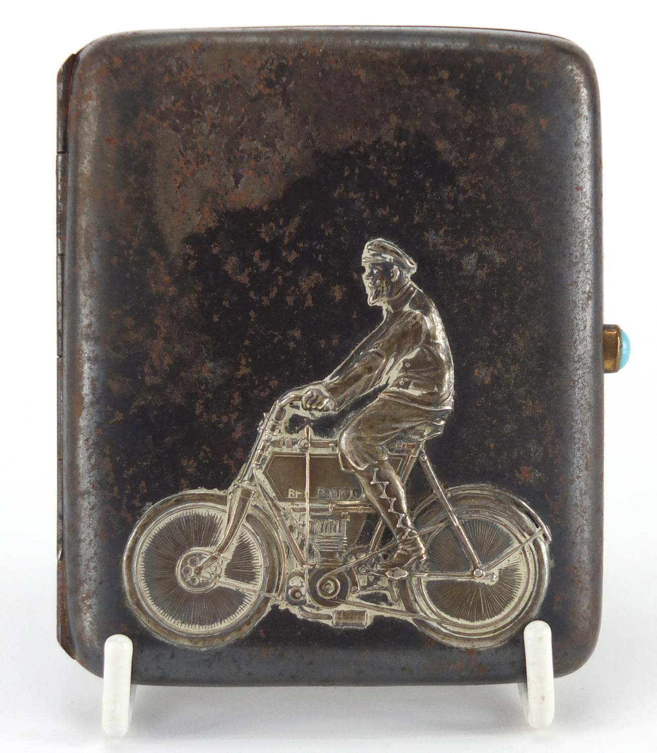 Lot 32 - Rectangular silver and gunmetal cigarette case, decorated with a gentleman on a motorcycle, London