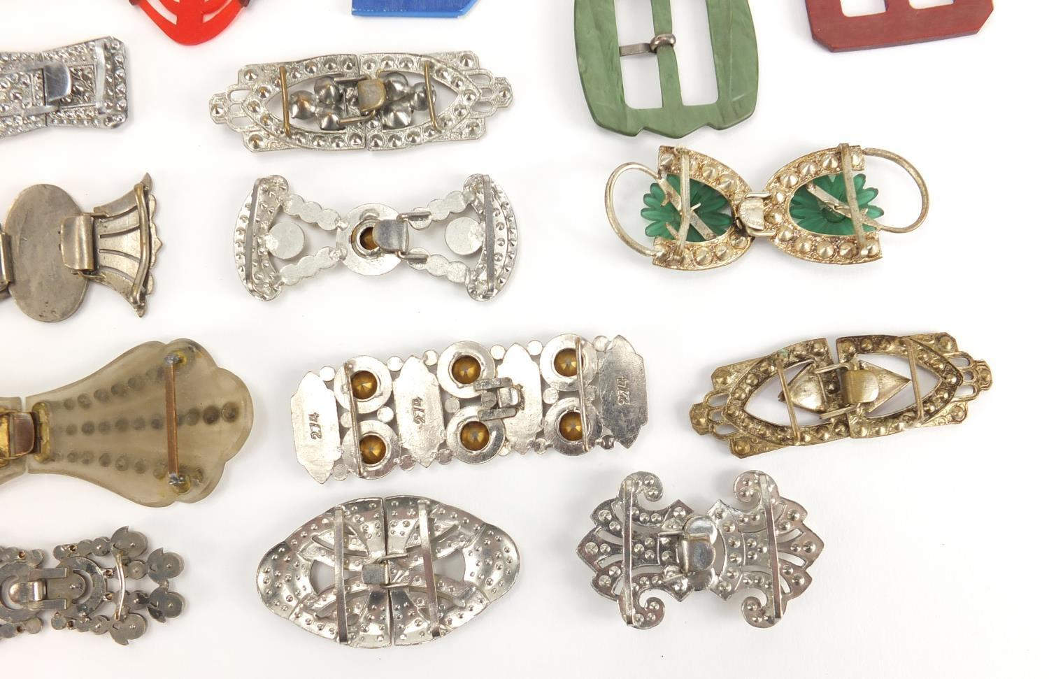 Lot 24 - Art Deco and later buckles, some two piece including Bakelite and Marcasite, the largest 10.5cm wide