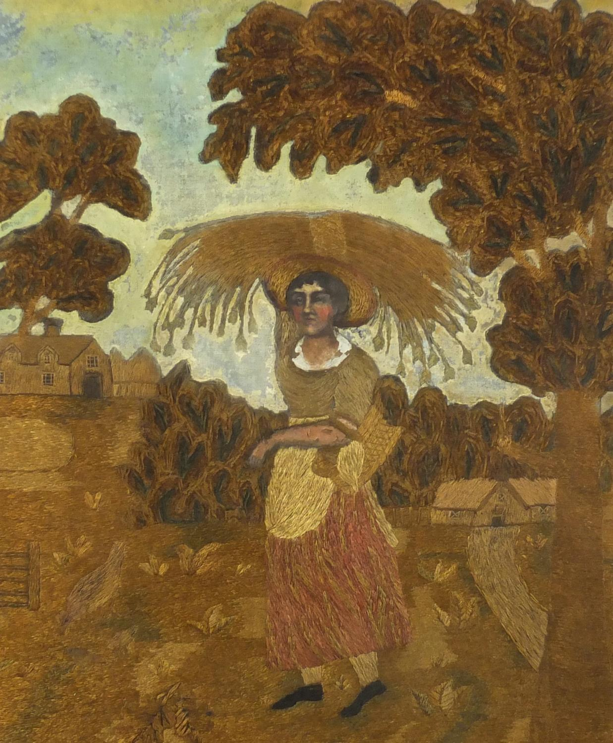 Lot 29 - Georgian silk wool work embroidery depicting a female carrying wheat before buildings, mounted and