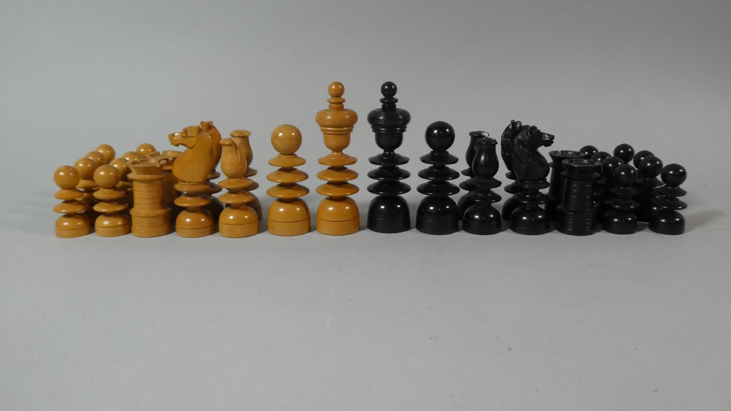 Lot 147 - A Complete Set of Turned and Carved Wooden Staunton Chess Pieces, King 10cm High