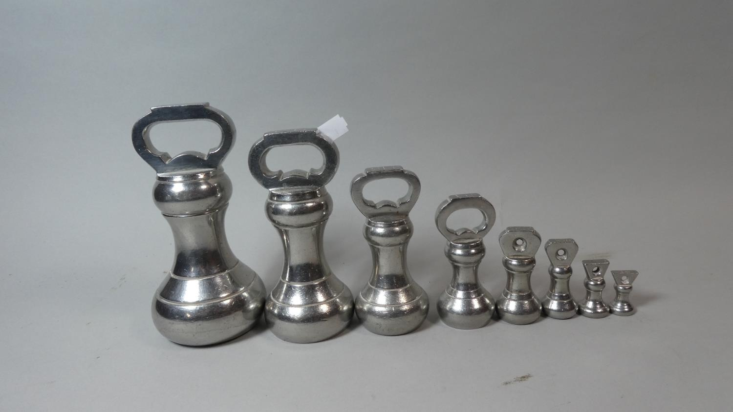 Lot 20 - A Good Set of Eight Silver Plated Bell Weights with Dates From 1937 and 1946, Ranging 7lbs to 1oz