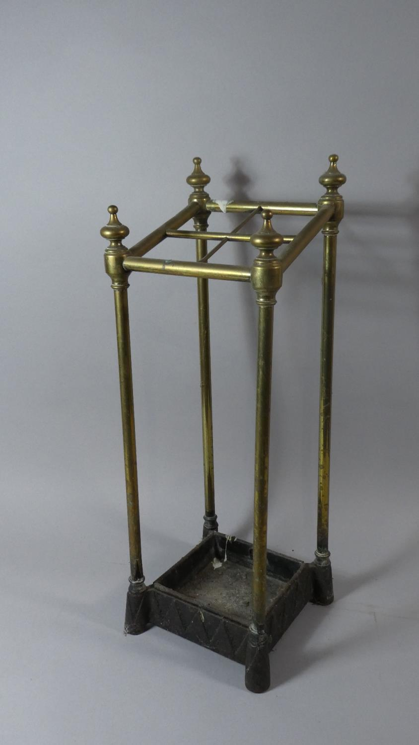 Lot 34 - A Late Victorian Brass Four Division Stick Stand with Original Drip Tray, 62cm High