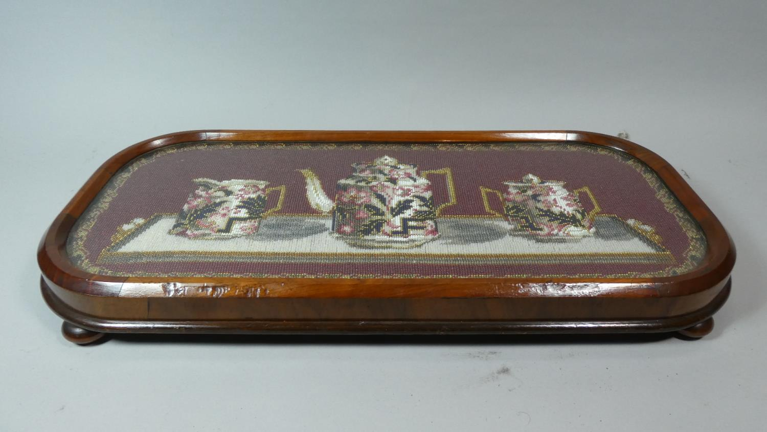 Lot 14 - A Walnut Framed Beadwork Stand Decorated with Imari Teaservice Decoration, 57cm WIde