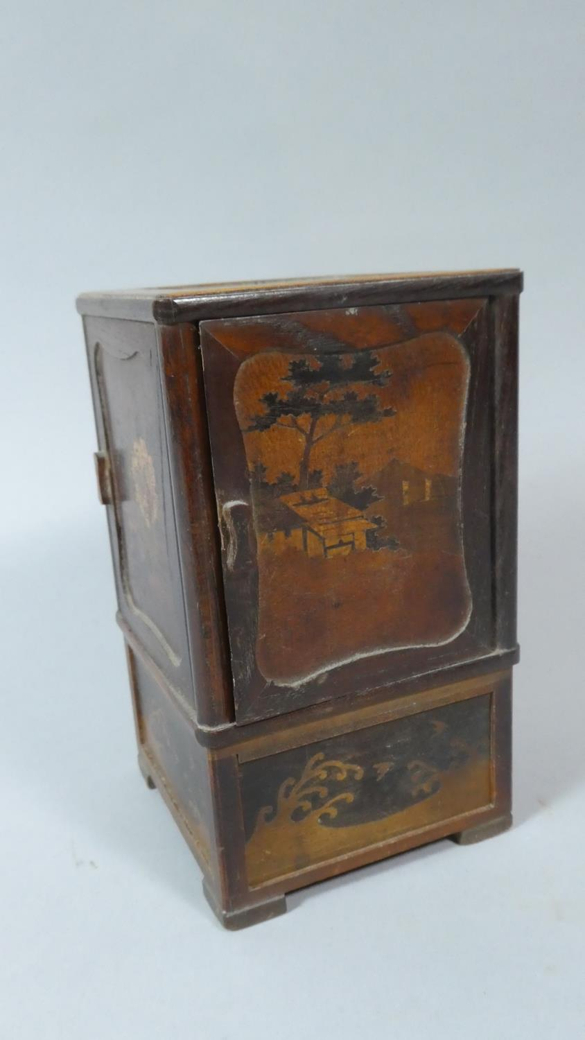 Lot 5 - A Miniature Japanese Cigarette Box with Four Hinged Doors and Inlaid Decoration, 16cm High