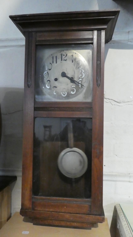 Lot 82 - An Edwardian Wall Clock