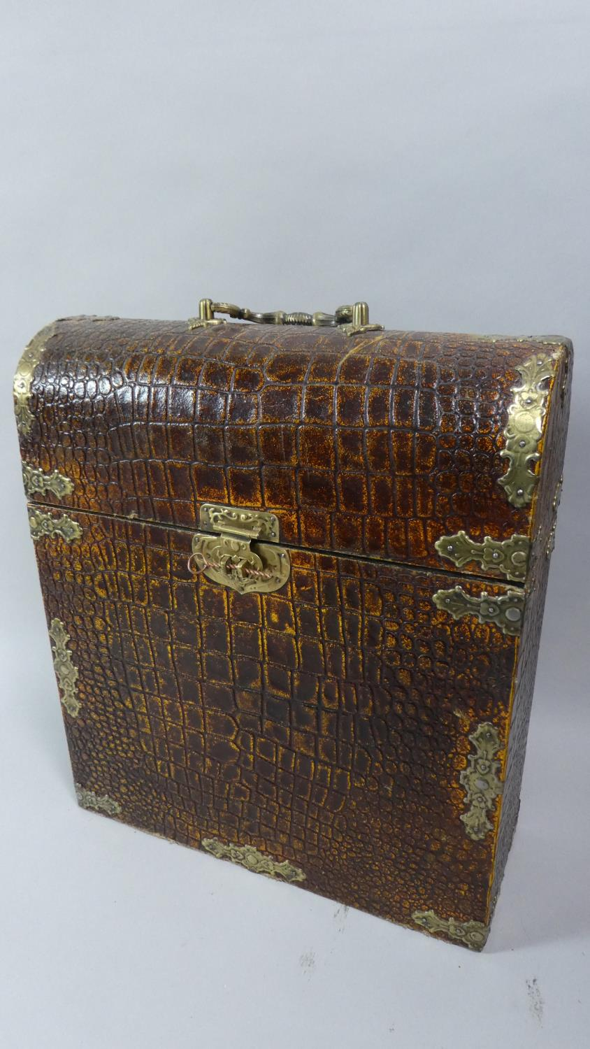 Lot 48 - A Faux Crocodile Skin Dome Top Wooden Box with Brass Clasp and Carrying Handle, 36cm High