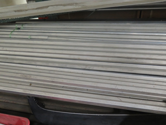 Lot 236 - Large Quantity of Aluminum and Stainless Steel Round, Rectangular and Hex Bar Stock, Cut Machine